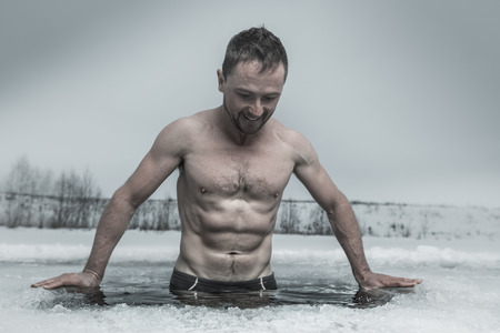 plunge: Man bathing in the ice hole