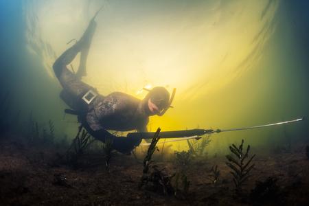 speargun: Underwater shot of the man with speargun