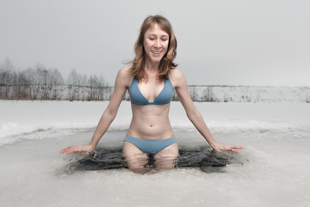 Young lady going to swim in the ice hole