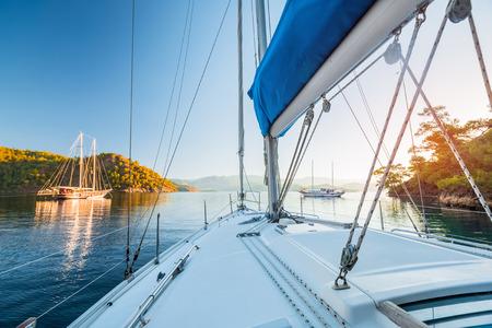 anchor marine: Sailing boats anchored in calm bay. Aegean Sea, Turkey
