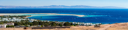 windsurfers: Panorama of the lagoon full of windsurfers in the town of Dahab, Egypt Stock Photo