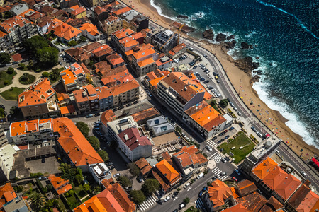 aerial: Aerial view of the coastline with beach in the city of Porto, Portugal