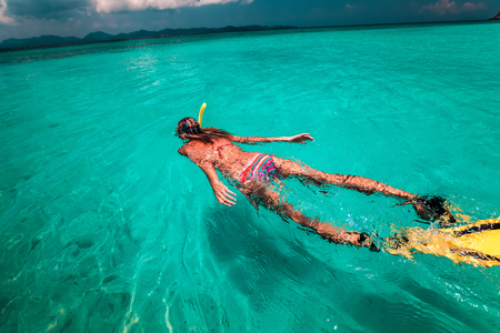 free diving: The young lady is swimming with snorkel and fins