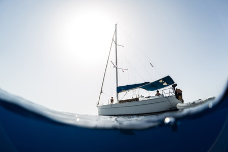 sail boat: Split shot of the sail boat on surface and its underwater view