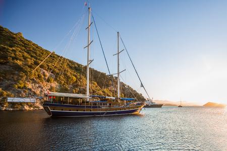 Calm bay with anchored sail boats. Turkey