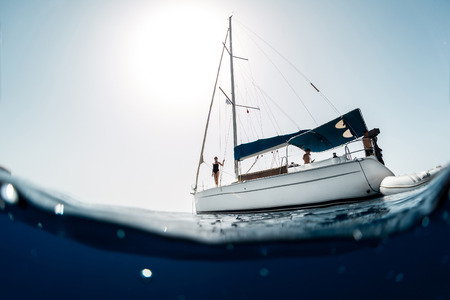 sailing yacht: Young people on a yacht at sea