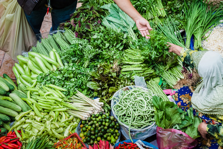 purchaser: The purchaser takes the product from the seller at the vegetable market