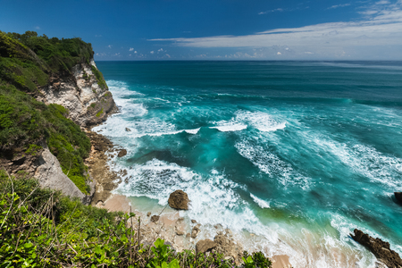 the oceans: Indian oceans coast with bracking waves and blue sky with some clouds. Bali, Indonesia