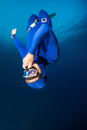 freediving: Freediver descending with monofin. Free immersion discipline Stock Photo