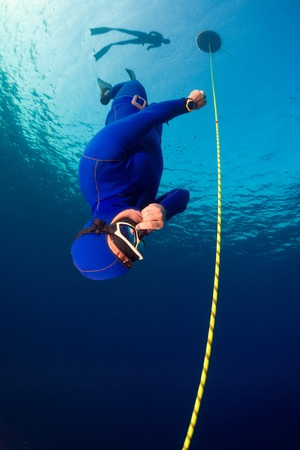immersion: Freediver descending along the rope. Free immersion discipline