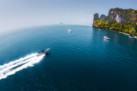 speedboat: View of the island in Andaman sea with speedboat in a clear water, Thailand Stock Photo