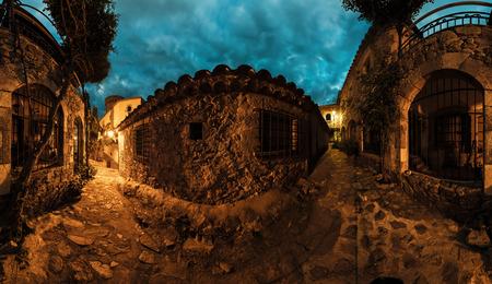 spanish village: Panorama of the narrow street in historical part of spanish village of Tossa de Mar, Spain Stock Photo