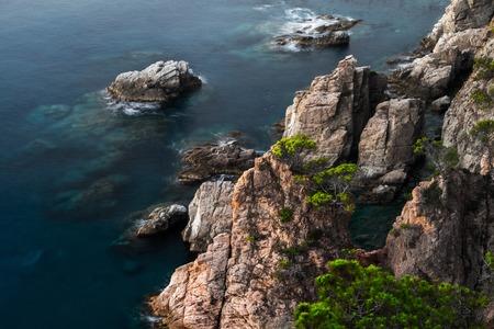 Sea with rocks at sunrise, Tossa de Mar