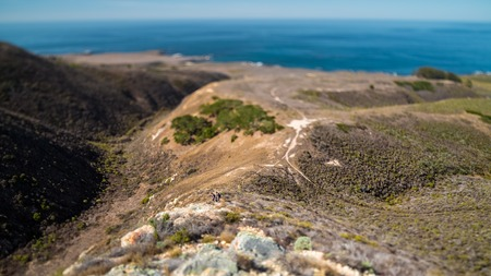 Hikers in the valley from the top. Tilt shift effect