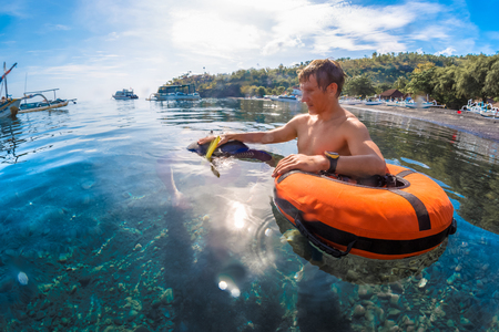 Free divers training in low water in the sea near the coast, Amed, Indonesia Stock Photo