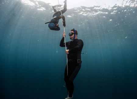 Free diver performing warm up dive - static apnea on the depth Stock Photo