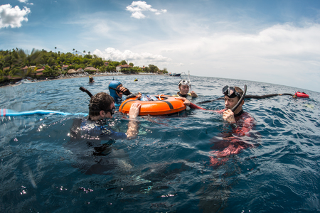 freediving: Free divers training in the tropical sea near the coast, Amed, Indonesia