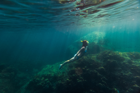 bottomless: Underwater shot of the lady moving on the breath hold in the depth