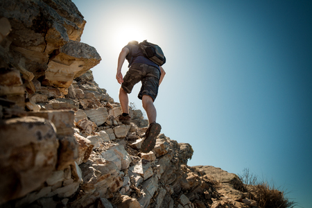 sports shoe: Hiker crossing rocky terrain in the Bryce Canyon National Park, USA