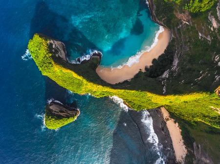 nusa: Aerial shot of the tropical coast of the island of Nusa Penida, beach of Kelingking, Indonesia