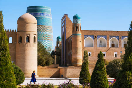 Oriental buildings with trees in the city of Itchan Kala. Khiva, Uzbekistan