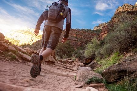 sports shoe: Hiker walking on the rocky path Stock Photo