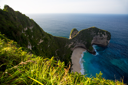 Tropical beach and cliff on the island of Nusa Penida, Indonesia