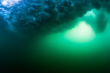 Underwater view of the wave breaking on sandy beach