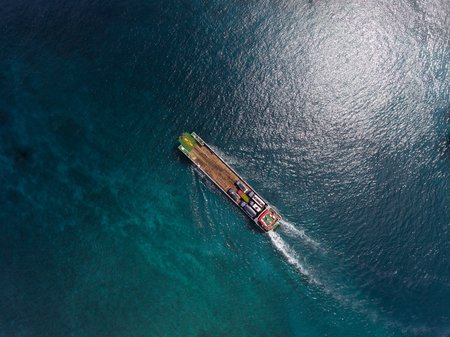Aerial shot of the cargo moving in the sea