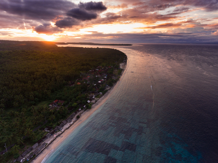 Aerial panorama of the coast of the island of Nusa Penida at sunset, Bali, Indonesia