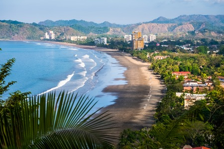 Tropical wide sandy beach of the town of Jaco, Costa Rica