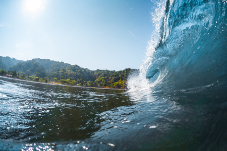 Wave breaking on the tropical shore Stock Photo