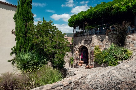 Paved street with shop in the fortress of the town of Tossa de Mar Stok Fotoğraf - 81153626