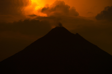 Night shot of the volcano of Arenal during thunderstorm. Costa Rica