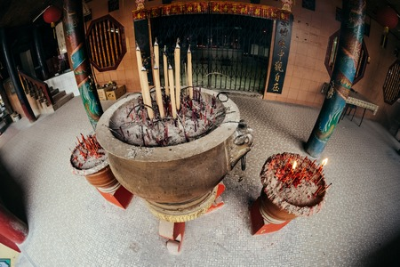 Incense sticks burning in the bowl at Chinese temple, Penang. Malaysia
