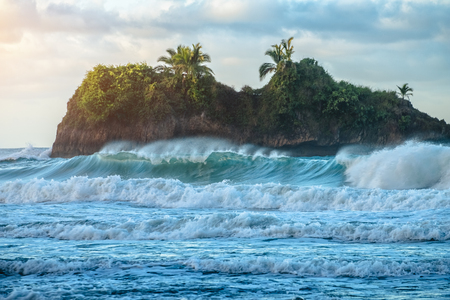 Islet in the sea with crashing waves