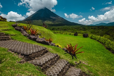 Volcano of Arenal with stone stairs on the foreground at sunny day. Costa Rica Stock fotó - 81153722