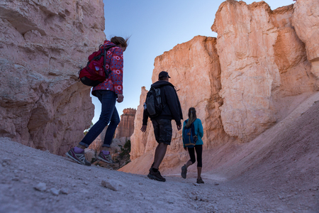 Hikers moving forward on the stone path in the Bryce Canyon National Park, USA photo
