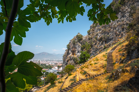 Fethiye rock tombs - 4th BC tombs carved in steep cliff. City of Fethiye, Turkey. Stock Photo
