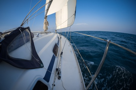 Yacht sailing in the tropical sea Stock Photo