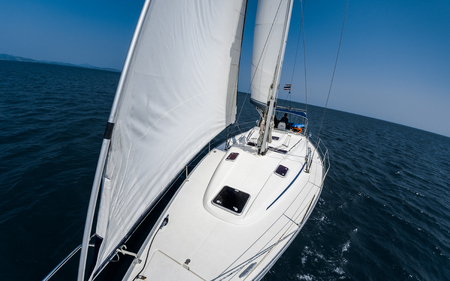 Sailing vessel moves in a sea under the sails Stock Photo