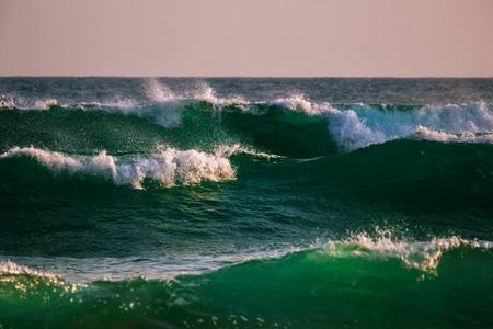 泡と緑の海の波 写真素材