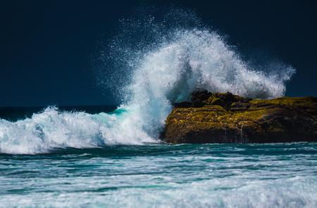 Powerful ocean wave breaking on the rock Stock Photo