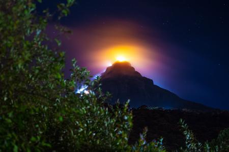 Illuminated mountain of Adams Peak at night. Sri Lanka