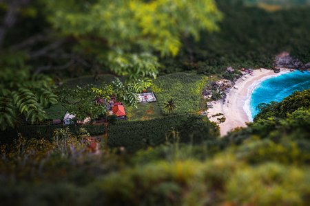 Tropical beach of Atuh surrounded by lush vegetation on the island of Nusa Penida, Bali, Indonesia. Tilt shift effect applied