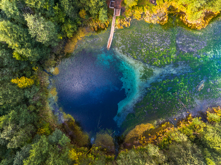 Aerial view of the karst lake named Goluboye Ozero (Blue Lake) surrounded by forest. Maximum depth is 18m (60ft). Lake is situated near the city of Kazan, Russia