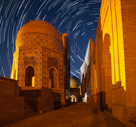 Ancient complex of buildings of Shakh i Zinda in the city of Samarkand with star trails, Uzbekistan