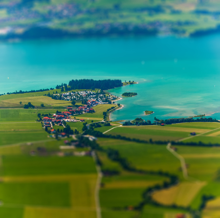 Little town on the coast of a lake surrounded by green fields. Germany 版權商用圖片