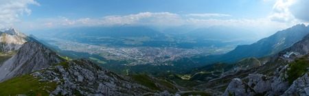 Panorama of the city of Innsbruk from top of mountain at sunny day Stock Photo