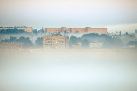 View of the buildings in the city of Izhevsk in a fog Фото со стока